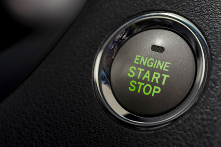 Car engine start and stop button. Interior detail.