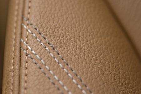 saddler: Leather background. Detail of car seat.