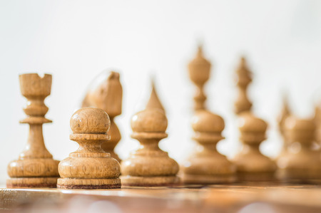 chellange: Wooden chess background.