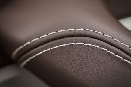 Leather background. Part of car seat. Macro photo.