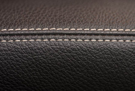 saddler: Leather background with stich. Car interior detail. Macro. Stock Photo