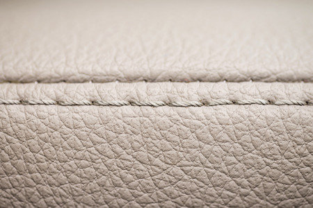 saddler: Leather background with stich. Detail of car interior. Macro. Stock Photo