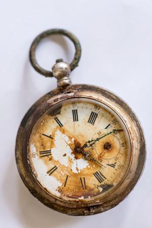 Old silver broken pocket watch.