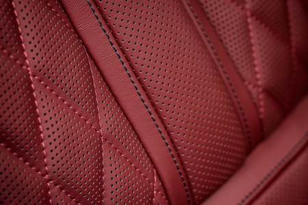 nervure: Car leather interior background. Part of seat. Macro.