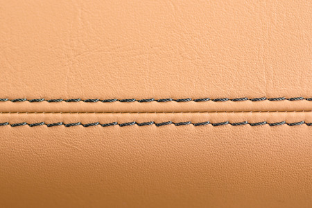 saddler: Car leather background with stich. Interior detail. Macro.