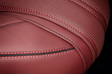 nervure: Business car leather seat. Interior detail. Macro.