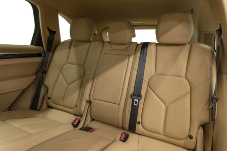 suede belt: Luxury car interior detail. Leather seats. Stock Photo