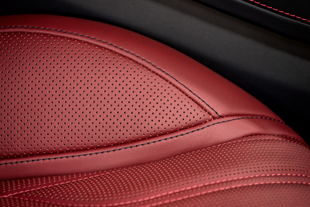 saddler: Car interior background. Part of leather seat. Macro.