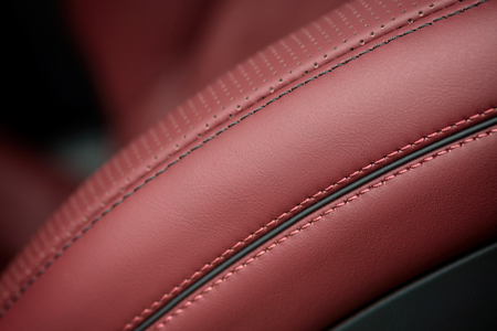 nervure: Car leather seat material with stich. Macro photo.