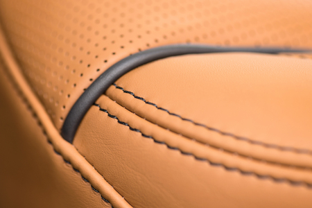 nervure: Part of leather car seat with stich. Macro.