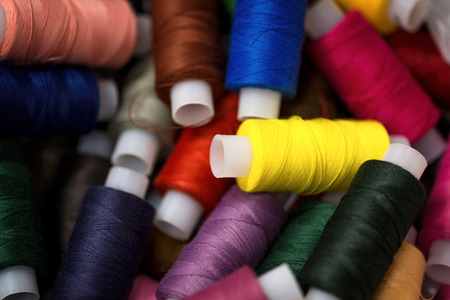 Many reels of threads for embroidery. Colorful macro background.