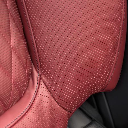 saddler: Leather material in modern car seat. Macro photo.