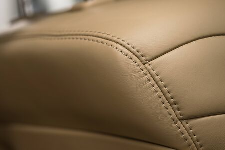 Car interior detail background. Part of leather seat. Macro photo.
