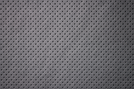 Modern car perforated leather. Interior detail. Macro.