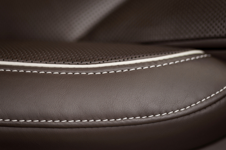 Modern leather car seat detail. Macro photo.