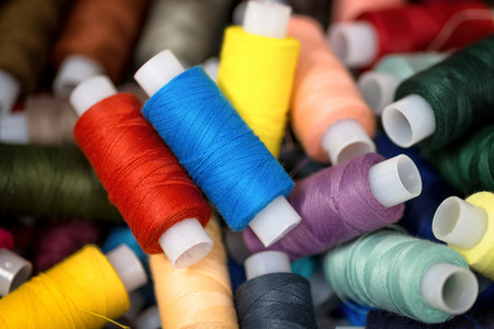 Many colorful reels of threads for embroidery. Macro background.