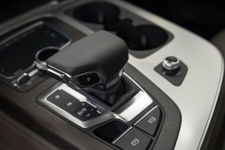 New business car automatic transmission. Interior detail. Stock Photo