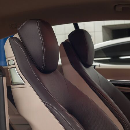 Modern car interior detail. Leather seats. Stock Photo