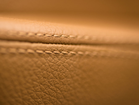 Car leather material. Interior macro photo background.