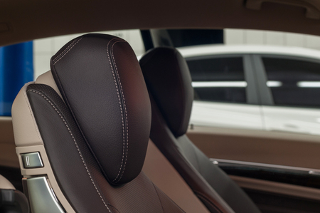 Modern car interior detail. Leather seats. Horizontal photo.