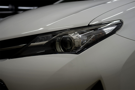 Modern car headlights. Exterior detail.
