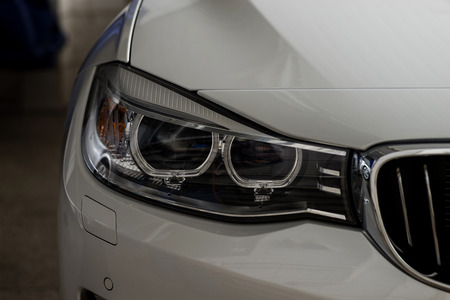 Closeup headlights of car. Exterior detail.