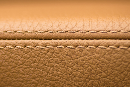 Car leather material. Interior background. Macro photo.