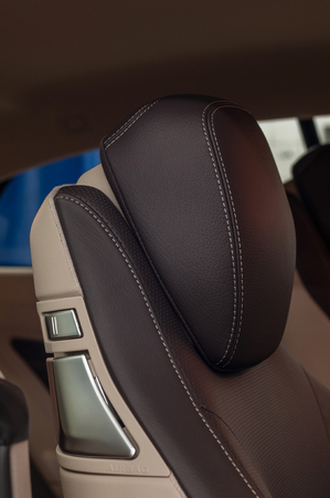 Modern car interior detail. Leather seats. Vertical photo.