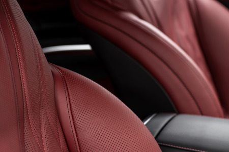 Modern luxury car interior background. Leather seats.