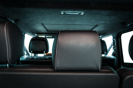 Modern car inside. Leather seats. Interior detail. View from back. Фото со стока
