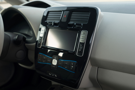 Modern car dashboard. Screen multimedia. Interior detail.
