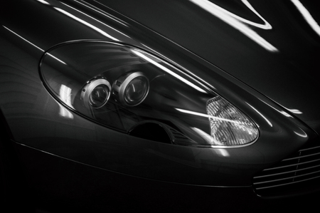 Modern sport car headlights detail. Фото со стока