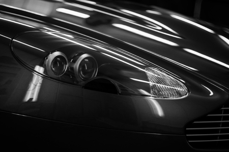 New sport car headlights. Exterior detail.