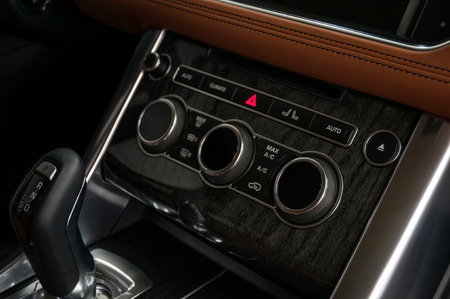 Modern car dashboard. Control buttons. Interior detail.