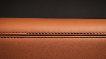 Car leather background with stich. Interior detail.