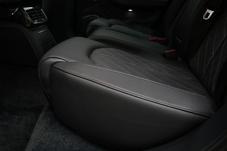 Modern car interior detail. Back passenger seats.