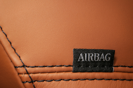 Word Airbag written on cars leather seat.