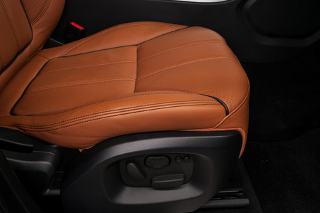 Modern car leather seat. Interior detail.