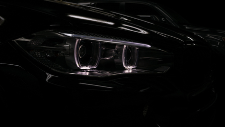 Modern car headlights detail.
