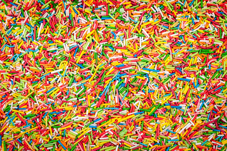 Sugar sprinkle dots. Decoration for cake and bekery. Many sprinkles as background.