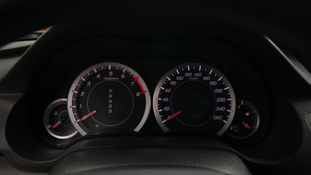 Modern car dashboard. Speedometer, RPM pointer, temperature, fuel tank. Фото со стока