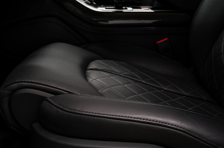 Leather seat in business car. Interior detail.