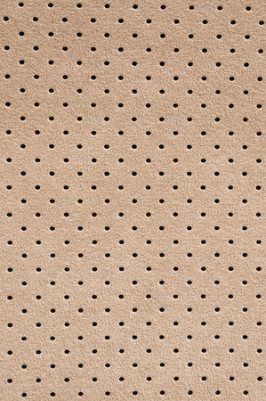 Perforated suede texture background. Car interior detail.