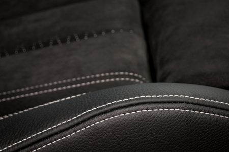 Detail of leather car seat texture. Фото со стока - 95457030