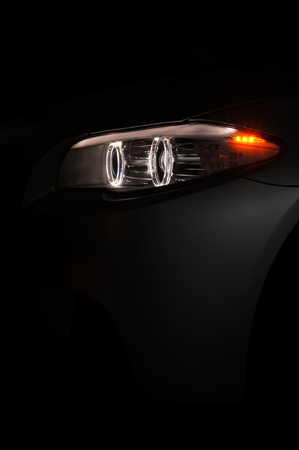 Modern car with backlight on black background. Vertical photo. Фото со стока - 95546674