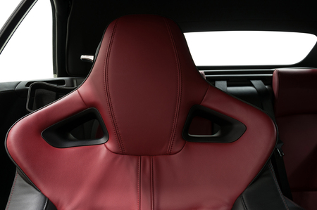 Modern car interior detail. Leather headrest.