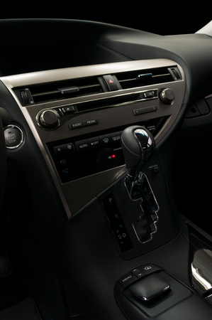 Modern car dashboard. Automatic transmission and control buttons. Фото со стока