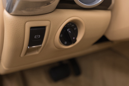 Luxury car control panel with parking button. Interior detail. Фото со стока