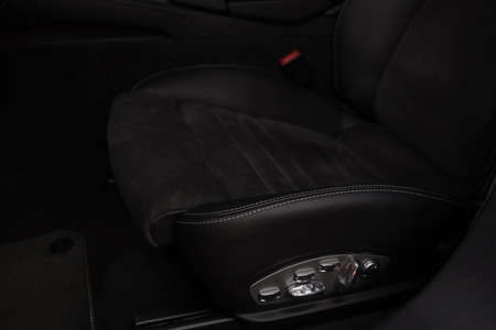 Black leather seat in sport car. Interior detail.