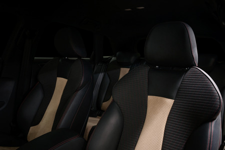 Leather seats in modern car . Interior detail.
